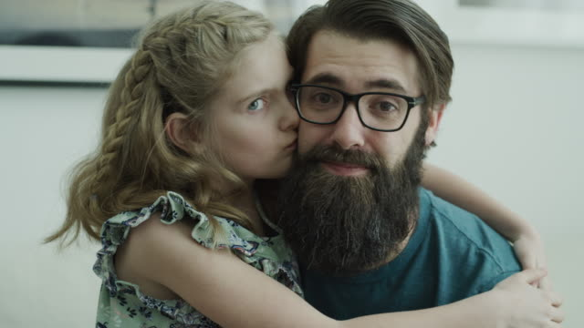 close up portrait of daughter kissing smiling father and looking at camera / lehi, utah, united states - lehi stock videos & royalty-free footage