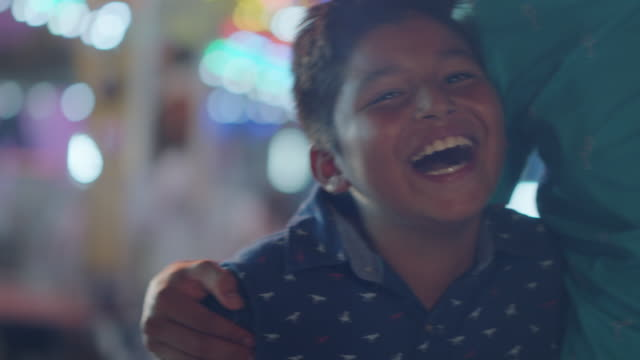 close up portrait of happy hispanic brothers at a summer carnival - latin american and hispanic ethnicity stock videos & royalty-free footage