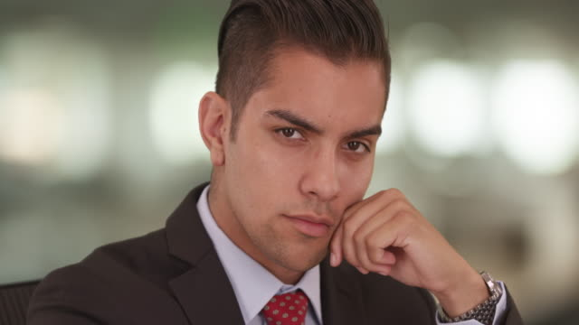close up portrait of hispanic business man looking at camera wearing suit and tie - neckwear stock videos and b-roll footage