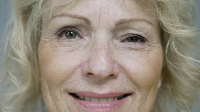 close up portrait of lighthearted mature caucasian woman - mature women stock videos & royalty-free footage