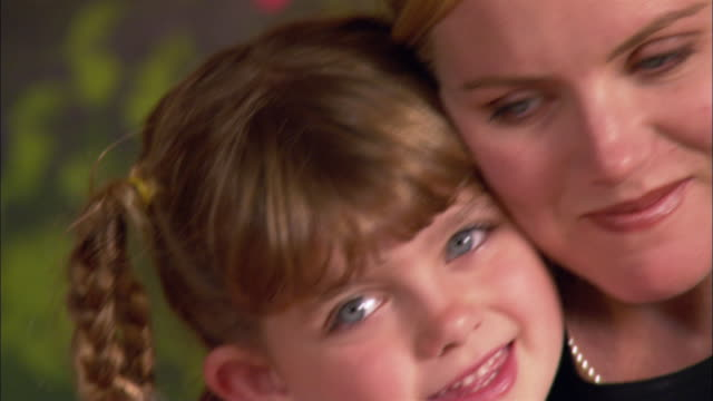 close up portrait of mother and daughter cheek-to-cheek / smiling - cheek to cheek stock videos & royalty-free footage