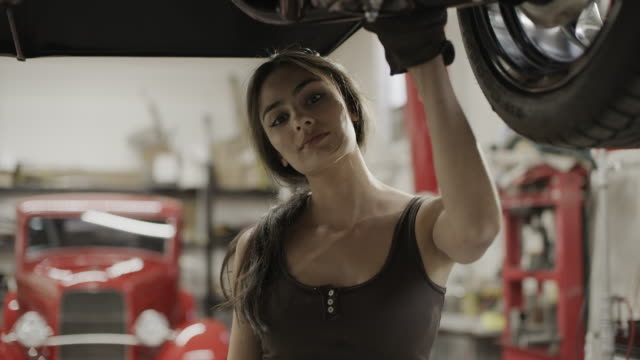 close up portrait of serious woman mechanic under car / pleasant grove, utah, united states - headshot stock videos & royalty-free footage