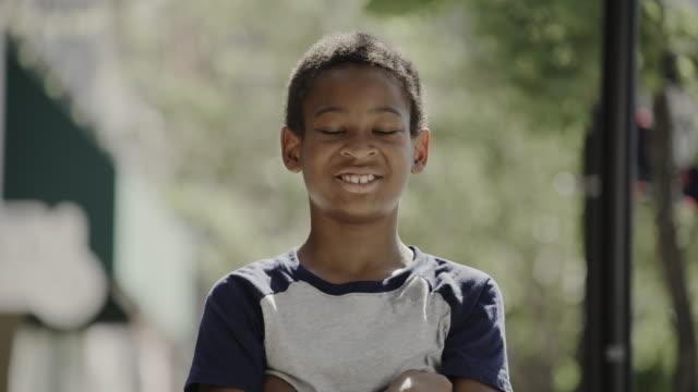 close up portrait of smiling confident boy / provo, utah, united states - provo stock-videos und b-roll-filmmaterial