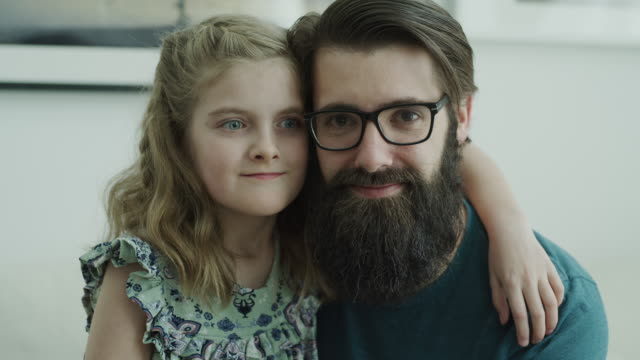 close up portrait of smiling father and daughter looking at camera / lehi, utah, united states - lehi stock videos & royalty-free footage