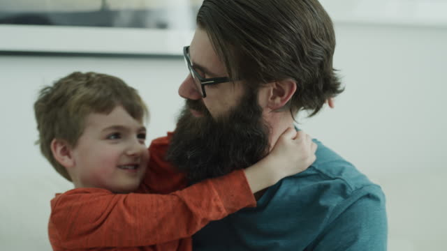 close up portrait of smiling father and son looking at camera / lehi, utah, united states - lehi stock videos & royalty-free footage