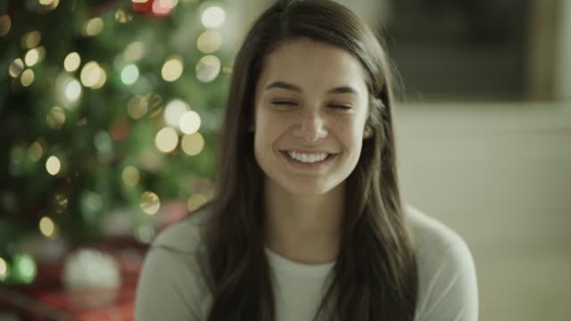 close up portrait of smiling girl near christmas tree / orem, utah, united states - orem stock videos & royalty-free footage