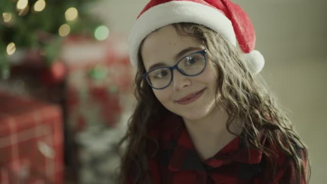 close up portrait of smiling girl wearing eyeglasses and santa hat on christmas / orem, utah, united states - orem utah stock videos & royalty-free footage