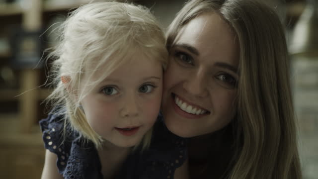 close up portrait of smiling mother and daughter / cedar hills, utah, united states - selective focus stock videos & royalty-free footage