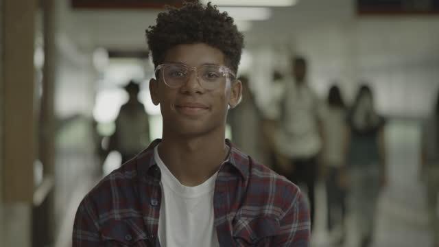 close up portrait of smiling teenage boy in high school corridor / springville, utah, united states - one teenage boy only stock videos & royalty-free footage