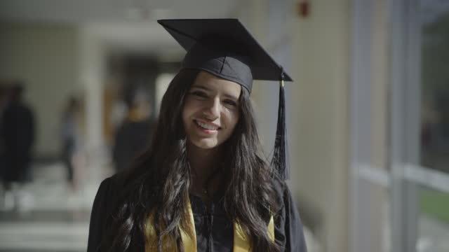 close up portrait of smiling teenage girl graduating from high school / springville, utah, united states - springville utah stock videos & royalty-free footage