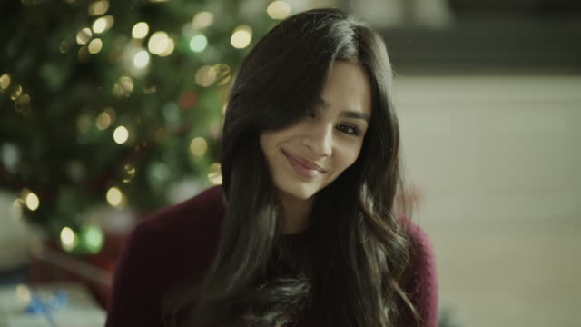 close up portrait of smiling woman near christmas tree / orem, utah, united states - orem bildbanksvideor och videomaterial från bakom kulisserna