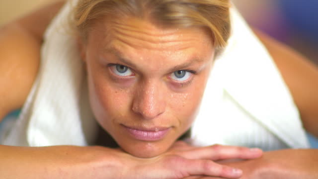 close up portrait of sweaty woman during workout - one mid adult woman only stock videos & royalty-free footage