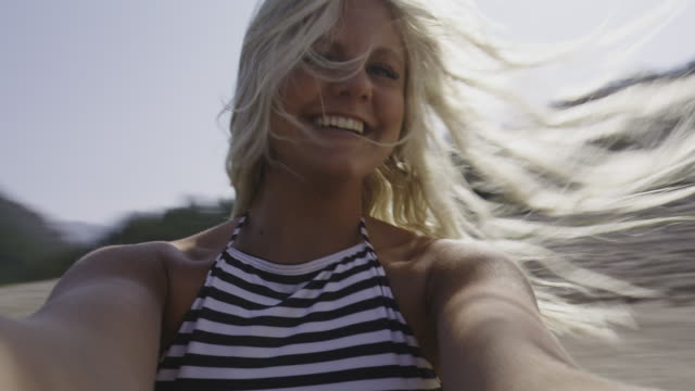 close up portrait of teenage girl spinning in circle at lake / tibble fork, utah, united states - only teenage girls stock videos & royalty-free footage