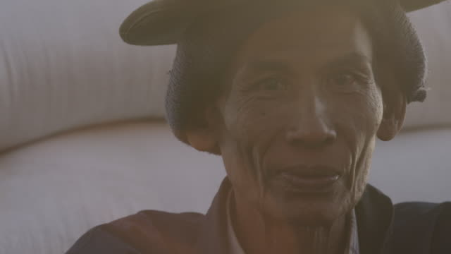 close up portrait of weathered man in myanmar. - weathered stock videos & royalty-free footage