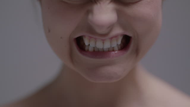 close up portrait of woman gritting her teeth and yelling - grimacing stock videos and b-roll footage
