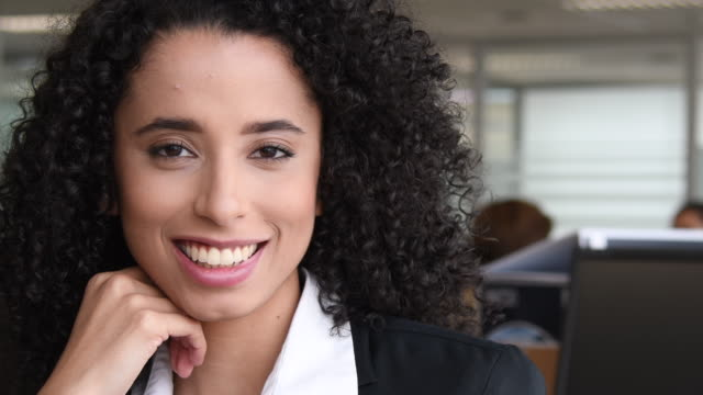 Close up portrait of young businesswoman smiling