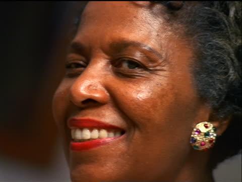 close up portrait senior black woman smiling + winking - winking stock videos & royalty-free footage