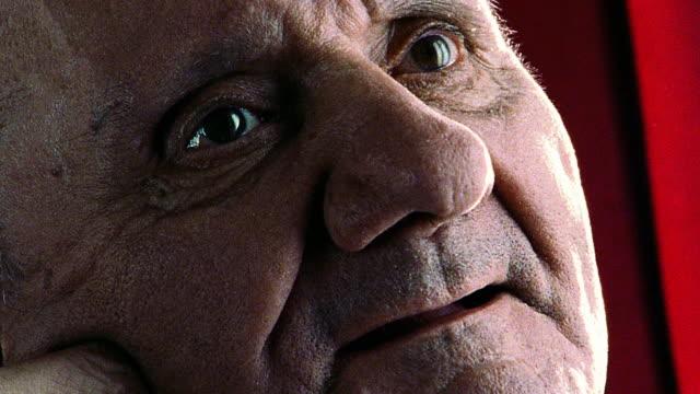 close up PORTRAIT senior man smiling into camera