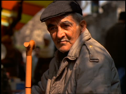close up portrait senior turkish man with mustache in hat holding cane outdoors / istanbul, turkey - moustache stock videos & royalty-free footage