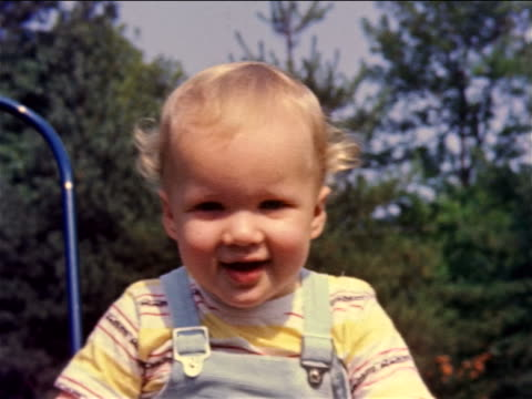1959 close up portrait smiling baby sitting outside / philadelphia, pa / documentary - 1959 stock videos & royalty-free footage