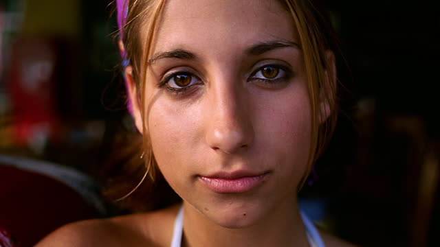 close up portrait teen girl looking at camera + smiling outdoors - forehead stock videos and b-roll footage