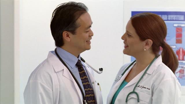 stockvideo's en b-roll-footage met close up portrait two doctors - overhemd en stropdas