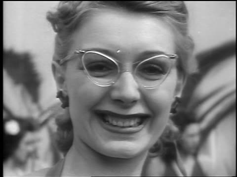 b/w 1941 close up portrait woman with cateye glasses smiling at camera / palisades park nj / newsreel - forehead stock videos & royalty-free footage