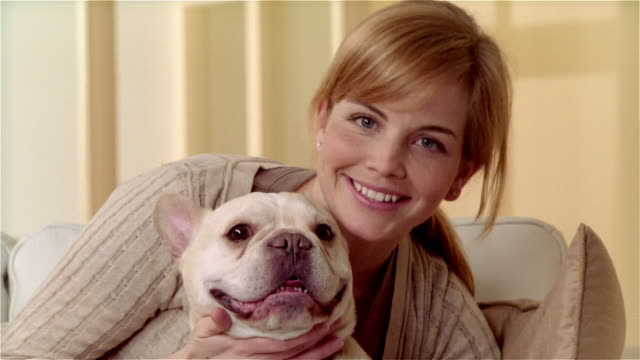 close up portrait woman with french bulldog - offenes lächeln stock-videos und b-roll-filmmaterial