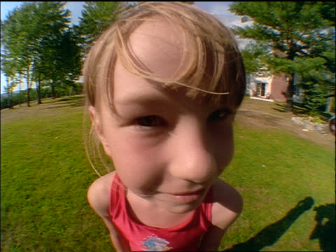 stockvideo's en b-roll-footage met fisheye close up portrait young blonde girl smiling at camera outdoors - alleen meisjes