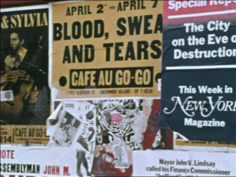 1969 close up posters advertising concerts on wall / greenwich village, nyc / industrial - greenwich village stock videos & royalty-free footage