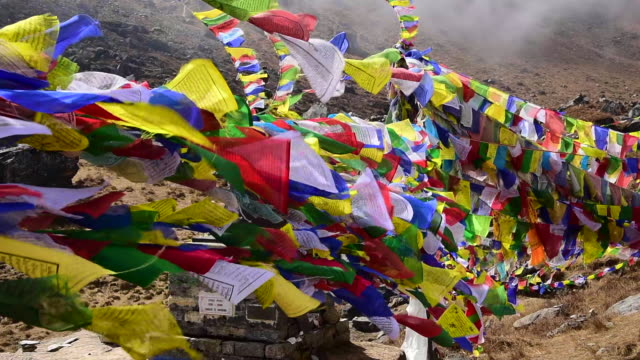 close up prayer flags on annapurna basecamp - annapurna range stock videos and b-roll footage