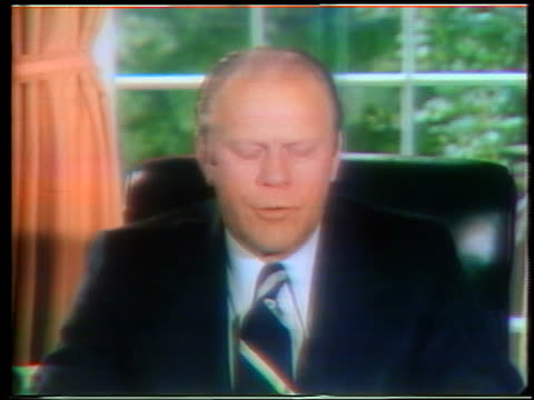 close up president gerald ford at desk making speech pardoning richard nixon - anno 1975 video stock e b–roll