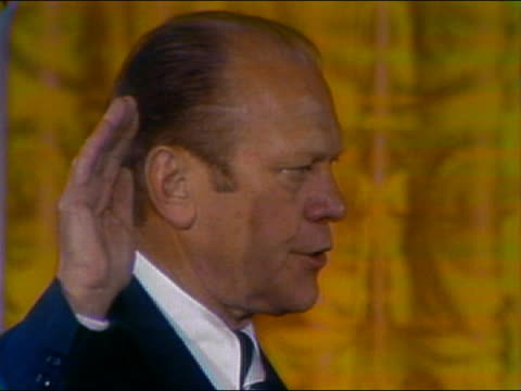 1974 close up President Gerald Ford holding up right hand and being sworn in