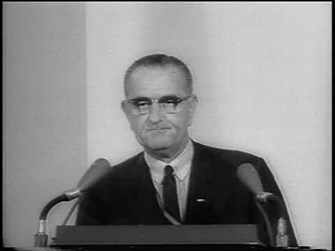 vídeos de stock e filmes b-roll de b/w 1964 close up president lyndon johnson at podium making speech about gulf of tonkin resolution - 1964