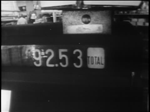 stockvideo's en b-roll-footage met b/w 1962 close up price being rung up on cash registers in grocery store / cuban missile crisis - 1962