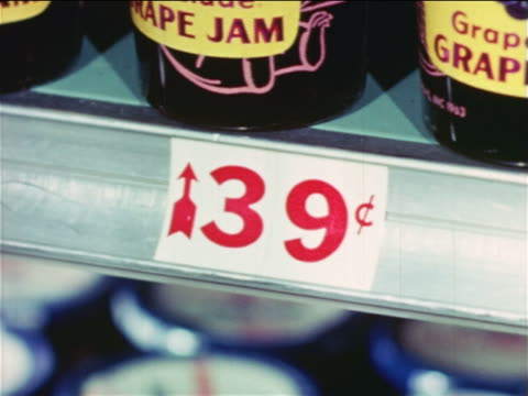1965 close up price sign for grape jam in grocery store / industrial