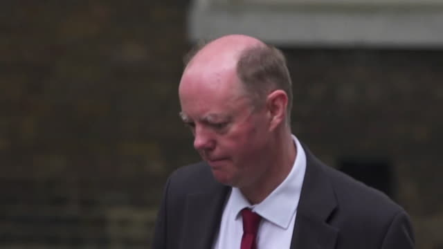 """close up professor chris whitty and sir patrick vallance uk government chief medical and scientific officer arriving at 10 downing street to give... - """"bbc news"""" stock videos & royalty-free footage"""