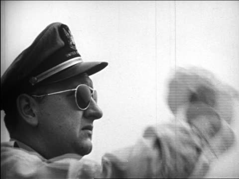 B/W 1948 close up PROFILE airplane pilot with hat + sunglasses saluting / industrial