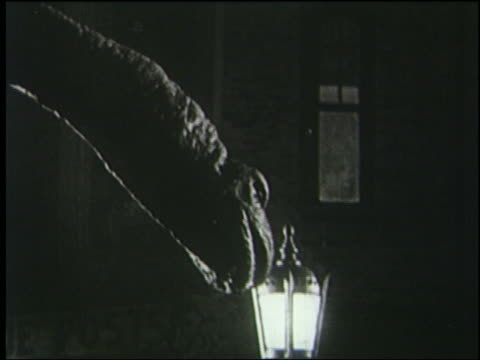 b/w 1925 close up profile brontosaurus roars at lamp in london at night - 1925 stock videos & royalty-free footage