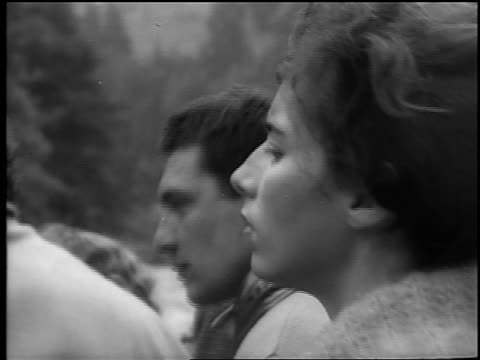b/w 1961 close up profile czech woman watching offscreen slalom competition / newsreel - 1961 stock videos and b-roll footage