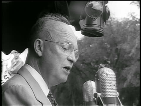 b/w 1952 close up profile dwight d eisenhower talks into microphone during whistlestop campaign - anno 1952 video stock e b–roll
