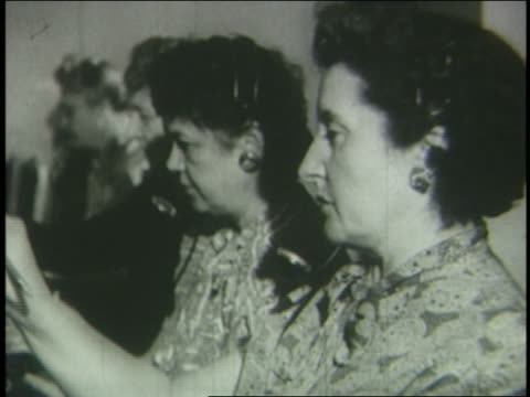 b/w 1951 close up profile female telephone operators working at switchboard - 1951 stock-videos und b-roll-filmmaterial