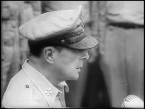 b/w 1945 close up profile general macarthur talking at japanese surrender aboard uss missouri / news - japanese surrender stock videos & royalty-free footage