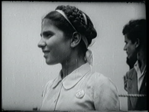 newsreel close up profile greek immigrant girl in braids / nyc - 1951 stock videos & royalty-free footage