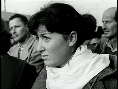 stockvideo's en b-roll-footage met b/w 1948 close up profile israeli woman sitting outdoors listening / israel / documentary - 1948