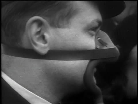 b/w 1939 close up profile male pilot wearing oxygen mask talking to woman wearing oxygen mask - oxygen mask stock videos & royalty-free footage
