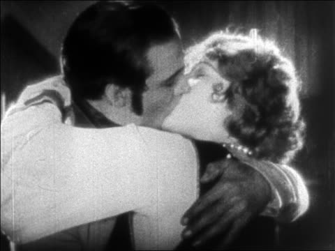 close up profile man + woman kissing / feature - anno 1925 video stock e b–roll