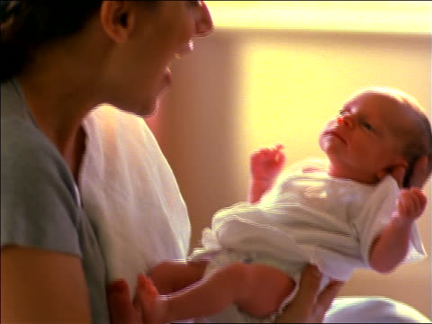 vidéos et rushes de close up profile mother holding + talking to newborn baby girl - bébé de 0 à 6 mois