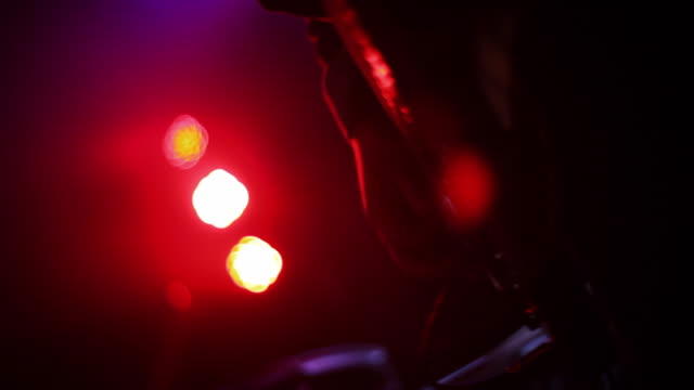 close up profile of guitar strumming on stage - electric guitar stock videos and b-roll footage