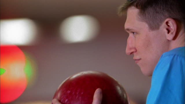 close up profile of man holding bowling ball up to his face - bowling ball stock videos & royalty-free footage